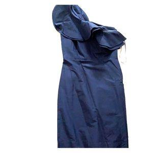Asymmetrical navy satin dress.